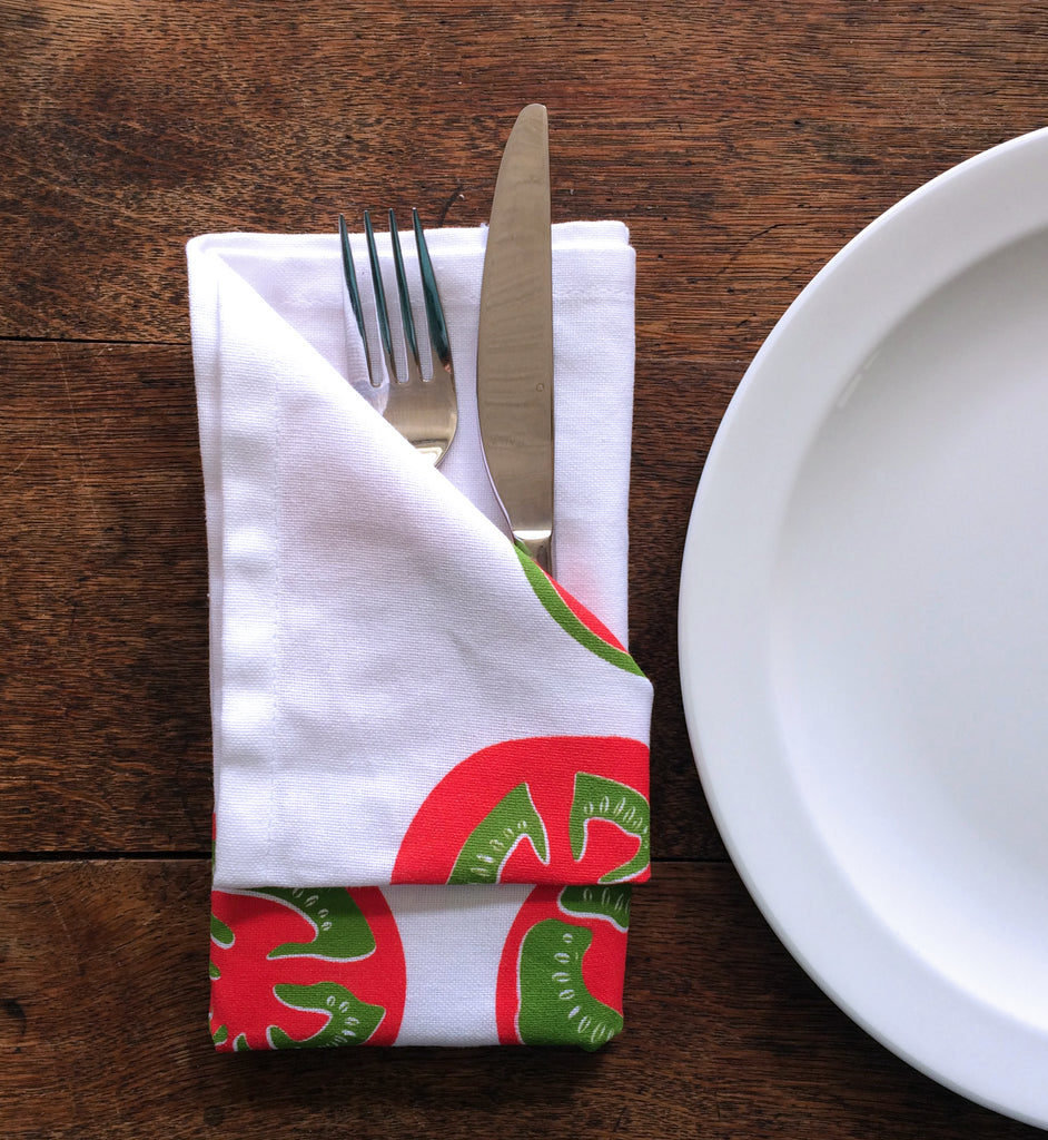 tea towel folded as a napkin with fork and knife