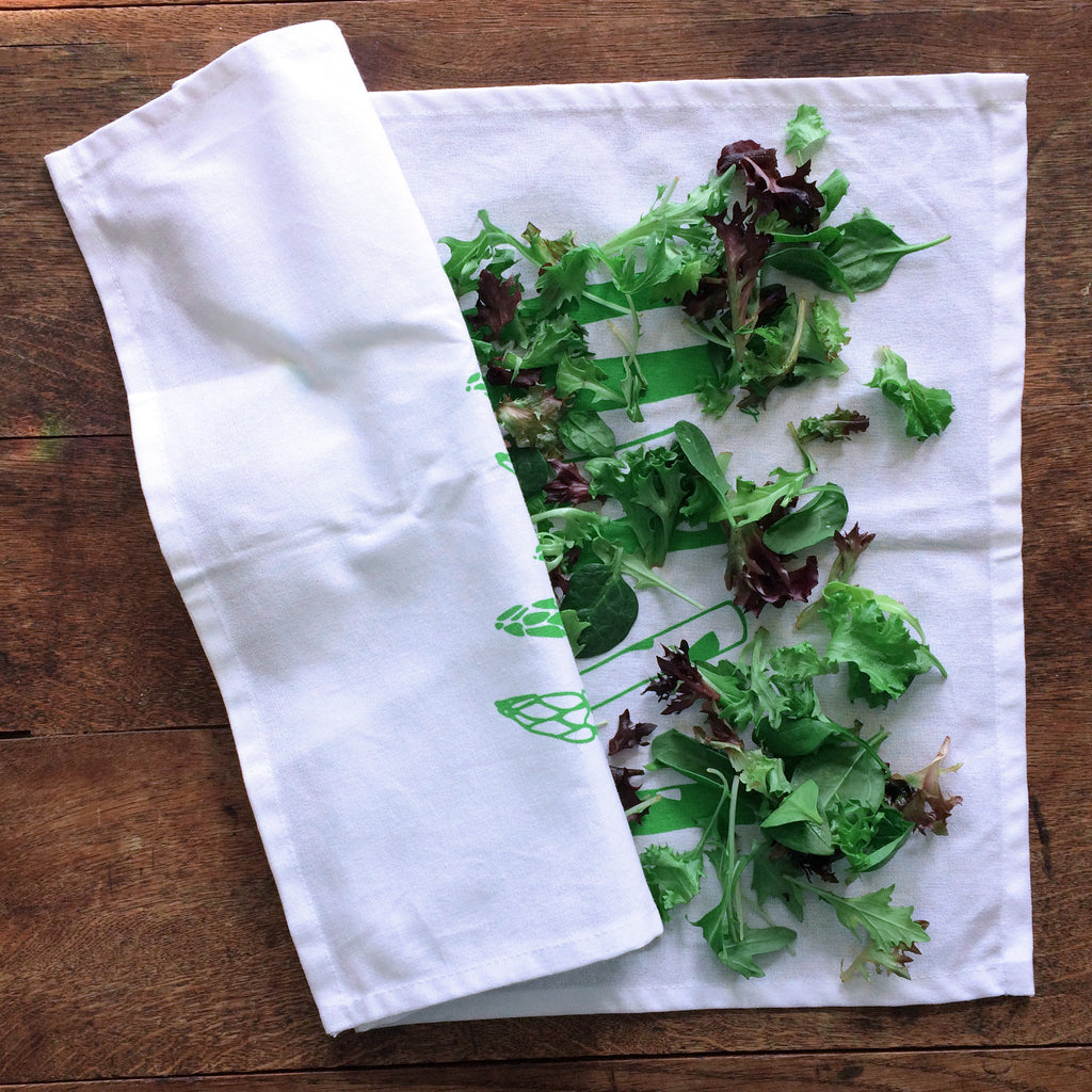 salad greens drying on a tea towel