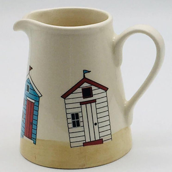 Hand painted small jug inspired by sunny days at the beach. 8cm by 9.5cm.