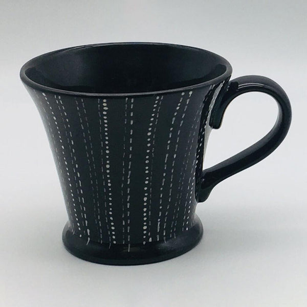 Contemporary hand finished black and white conical mug 11cm by 10cm.