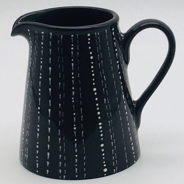 Contemporary hand finished black and white small jug 8cm by 9.5cm.