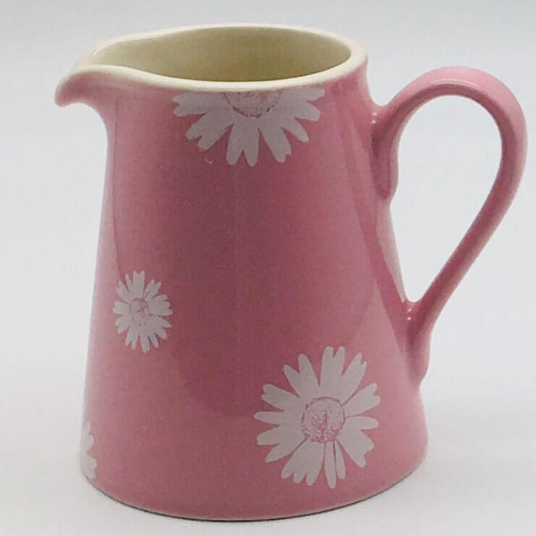 Beautiful pink pastel coloured small jug. Hand painted by our artisans. 8cm by 9.5cm.
