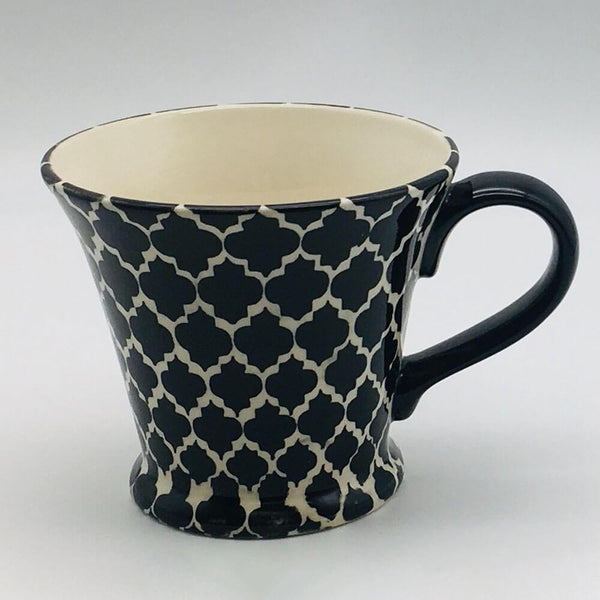 A stunning black Moroccan inspired conical mug beautifully painted using a hand cut sponge technique. 11cm by 10cm.