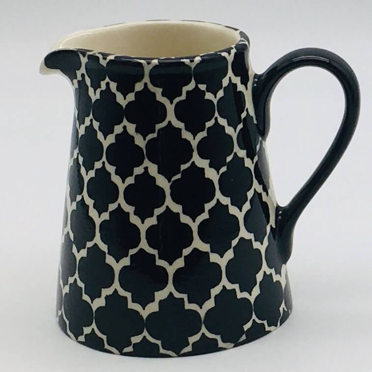 A stunning black Moroccan inspired small jug beautifully painted using a hand cut sponge technique. 8cm by 9.5cm.