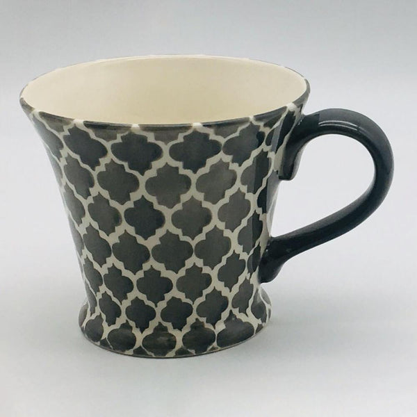 A stunning grey and white  Moroccan inspired conical mug beautifully painted using a hand cut sponge technique. 11cm by 10cm.