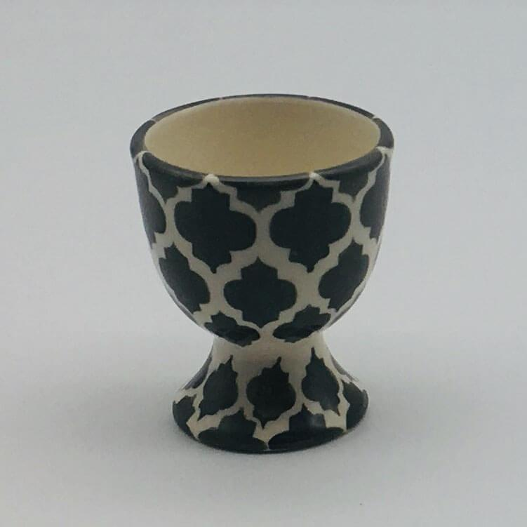 A stunning grey and white  Moroccan inspired egg cup beautifully painted using a hand cut sponge technique. 5.5cm by 6.5cm.