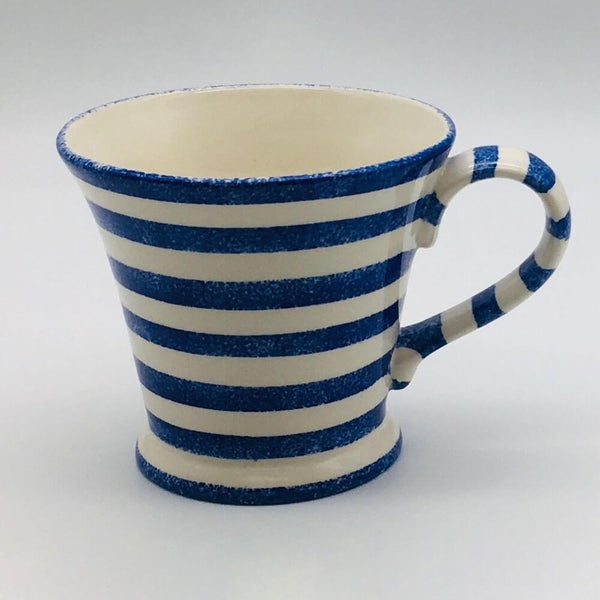 Beautiful blue and white striped conical mug with a design applied using a hand cut sponge effect. 11cm by 10cm.
