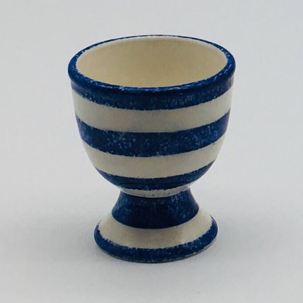 Beautiful blue and white striped egg cup with a design applied using a hand cut sponge effect. 5.5cm by 6.5cm.