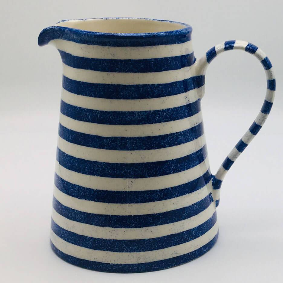 Beautiful blue and white striped large jug with a design applied using a hand cut sponge effect. 13cm by 20cm.