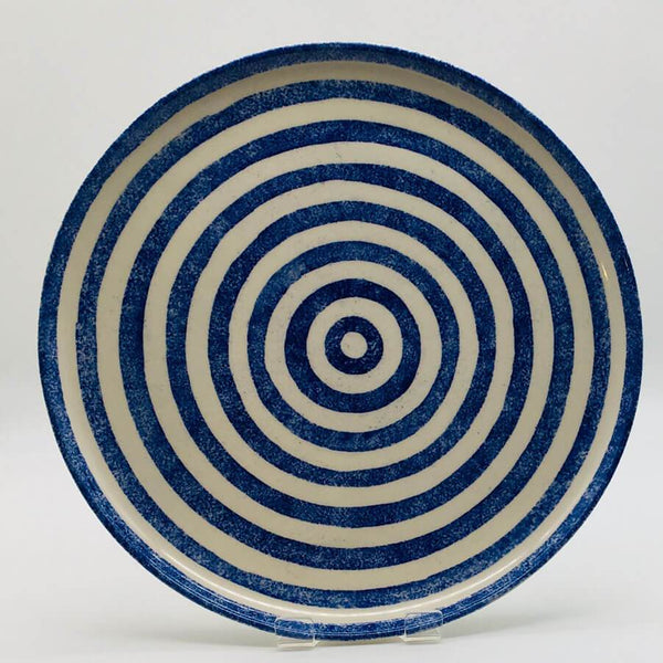 Beautiful blue and white striped dinner plate with a design applied using a hand cut sponge effect. Diameter 26.5cm.