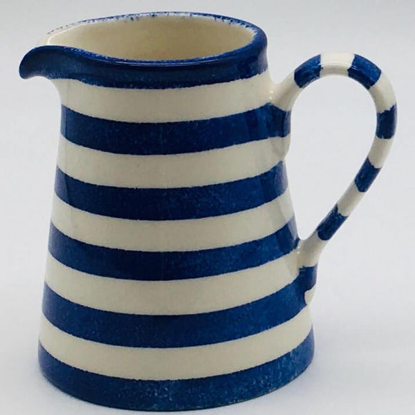 Beautiful blue and white striped small jug with a design applied using a hand cut sponge effect. 8cm by 9.5cm.