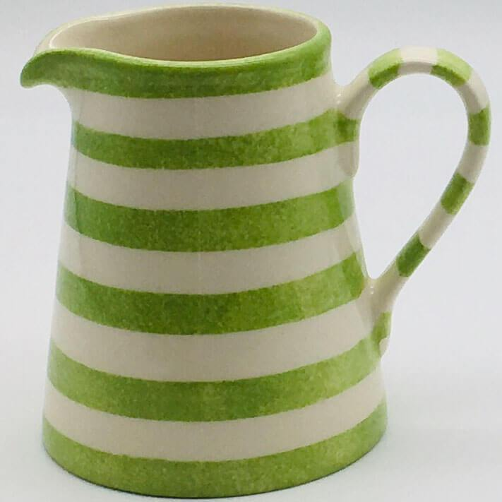 Beautiful green and white striped small jug with a design applied using a hand cut sponge effect. 8cm by 9.5cm.