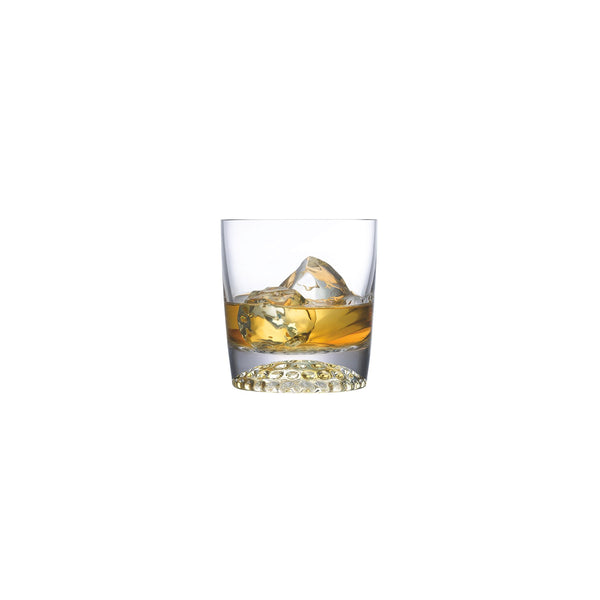 NUDE Ace whisky glass with golf pattern on the bottom filled with whisky