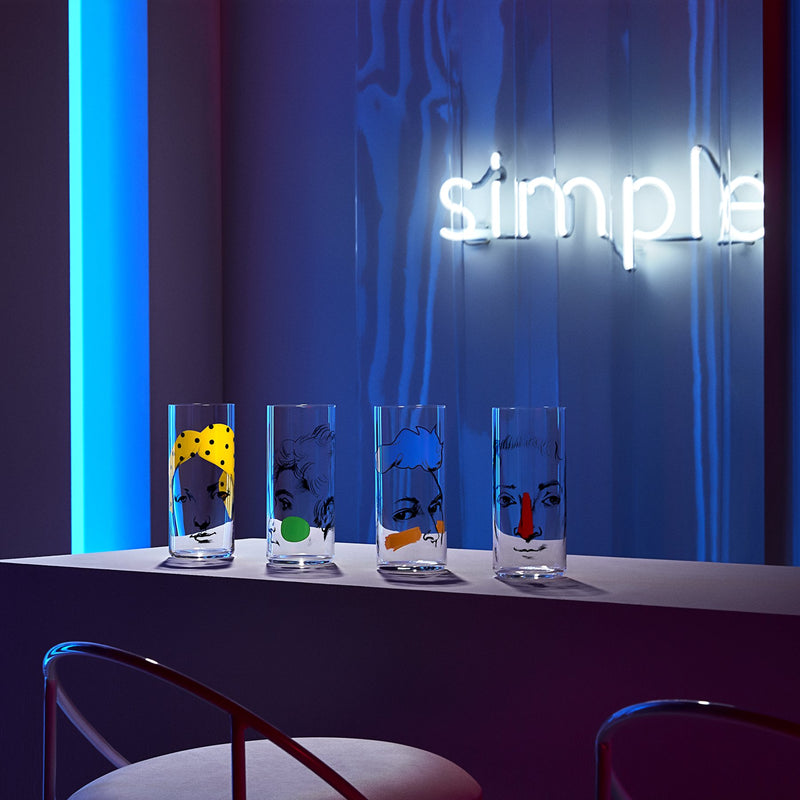 Lifestyle image of NUDE Rock & Pop high ball glasses in neon environment