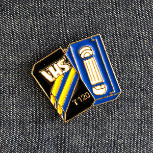 Vintage VHS Enamel Pin Badge on denim
