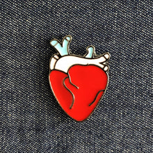 anotomical heart enamel badge on denim