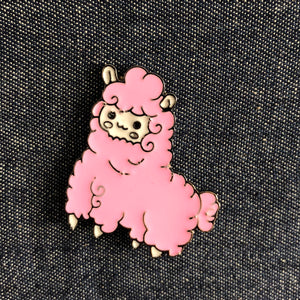 Pink Llama enamel pin badge on denim