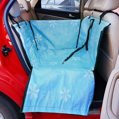 An image of a blue waterproof pet car seat from Petslop in the backseat of a red car.