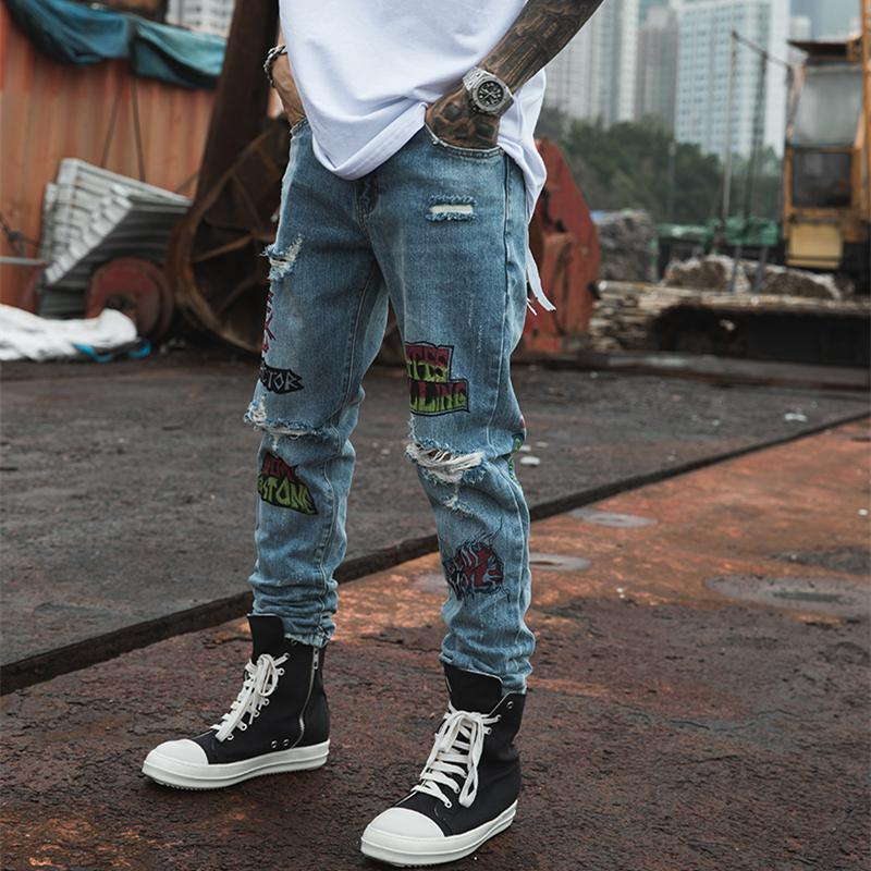 EXTINCTION DISTRESSED DENIM JEANS