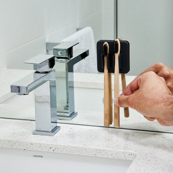 placing toothbrush in holder