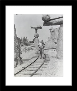 """Walt Walking on the Tracks of Rainbow Caverns Mine Train"" from Disney Photo Archives"