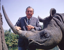 Load image into Gallery viewer, Publicity still of Walt Disney and a rhinoceros in the Jungle Cruise at Disneyland Park