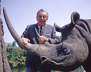 Publicity still of Walt Disney and a rhinoceros in the Jungle Cruise at Disneyland Park