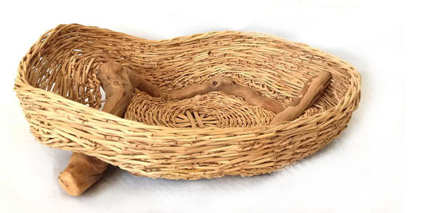 Open basket with grape branches