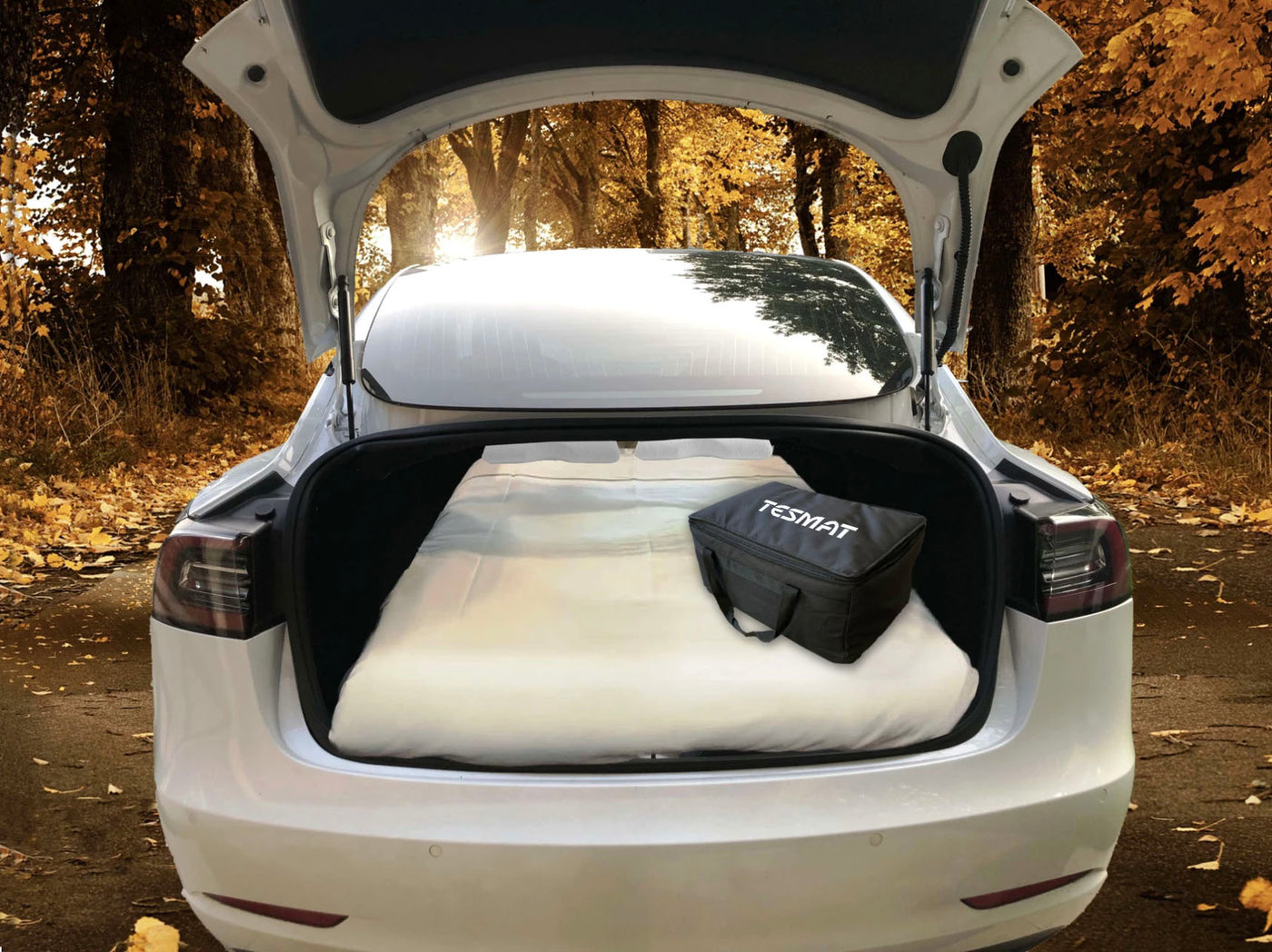 tesmat car camping mattress set up in tesla trunk