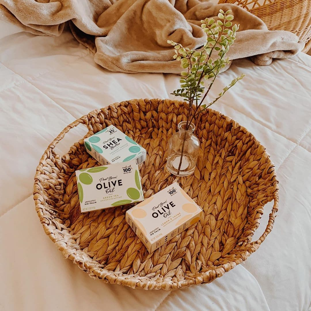 3 boxes of bar soap in a wicker basket