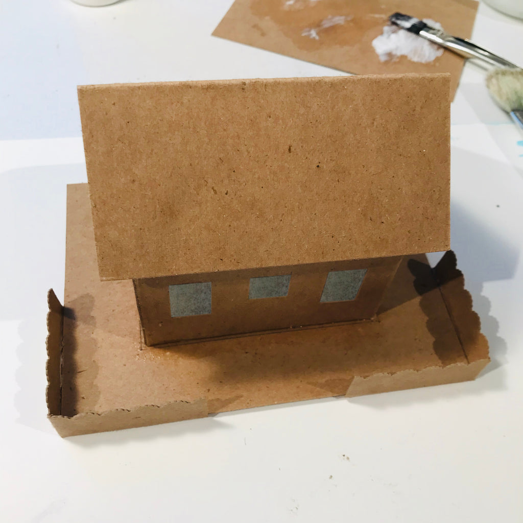 DIY Craft Tutorial - Christmas Village Putz Glitter House - Simple Cottage - Glue fence to the base and press down