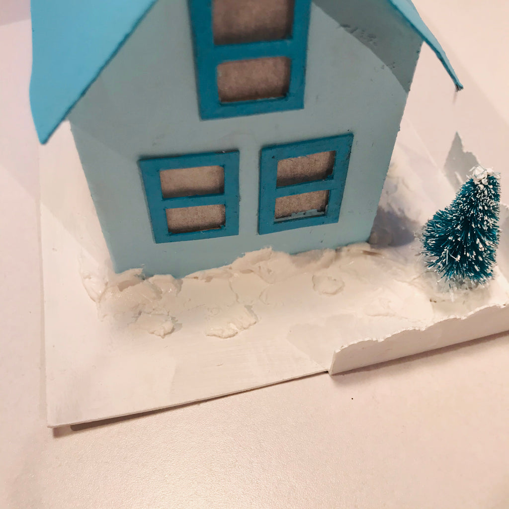 DIY Craft Tutorial - Christmas Village Putz Glitter House - Simple Cottage - Spread fake snow at the foot of the walls