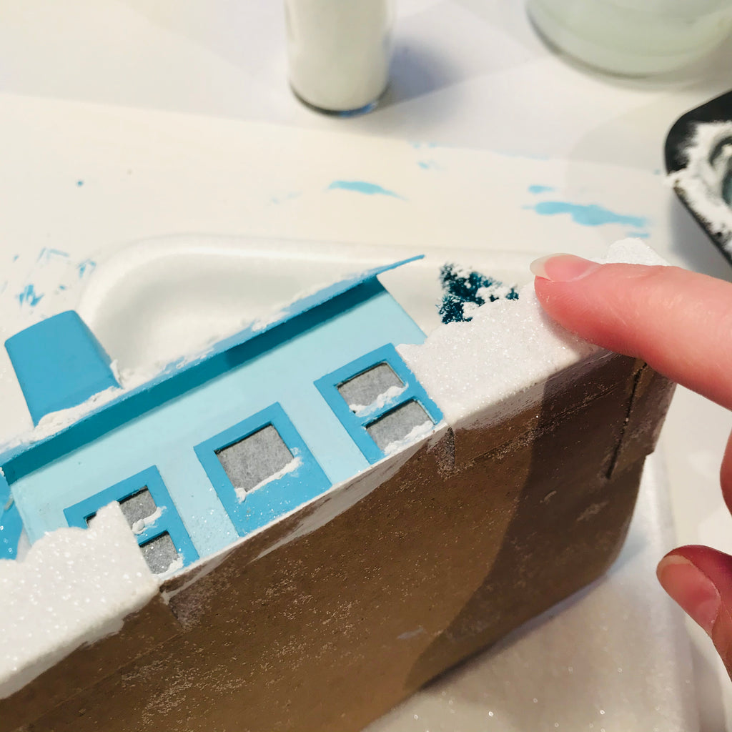 DIY Craft Tutorial - Christmas Village Putz Glitter House - Simple Cottage - Apply Mod Podge and glitter to fence