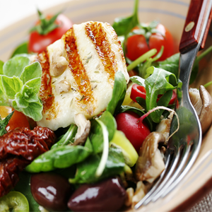 Grilled Goat Cheese with Salad and Pine Nut Seeds