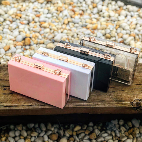 Hard case clutch bags with gold chains. A chic accessory for day or night.  Evening bag, evening clutch bag. Fashionable statement piece available in coral peach, white, black or transparent bag, transparent clutch bag.Available in various colours with 2 chain options (detachable).