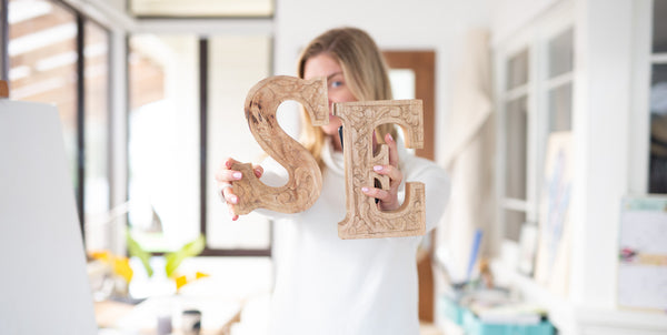 Stephanie Elizabeth holding letters S and E