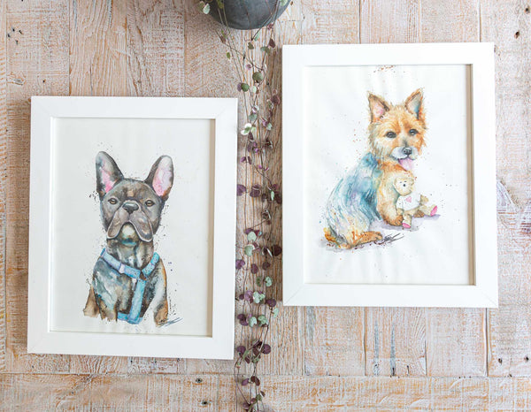 Two dog portraits framed in white timber