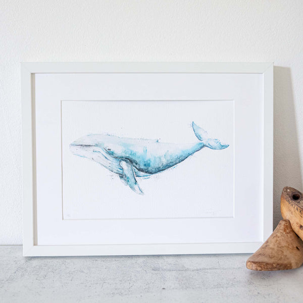 Framed white artwork of a humpback whale