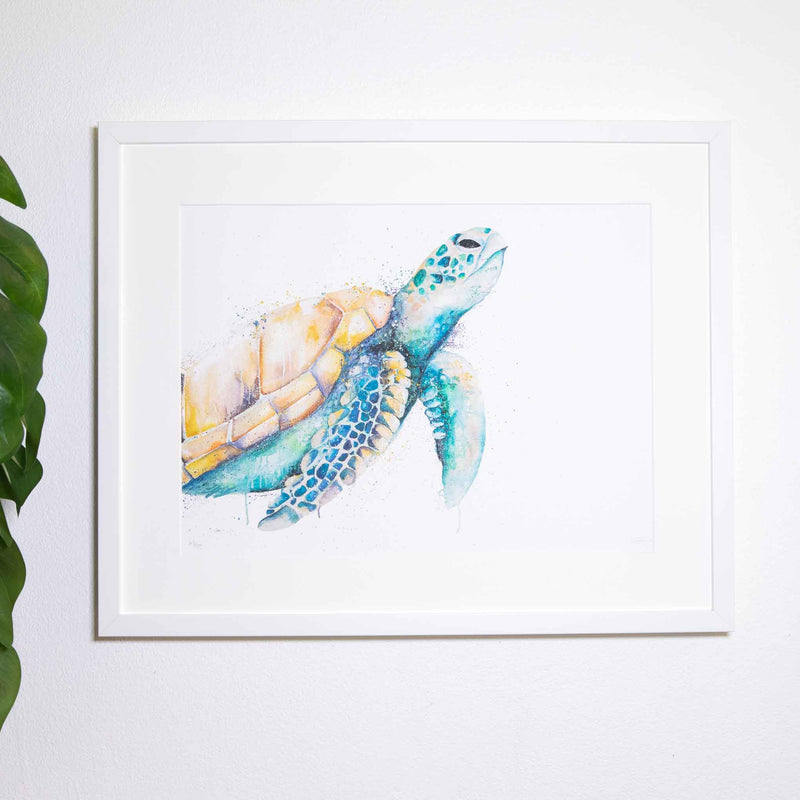 White print on wall with green sea turtle oil print