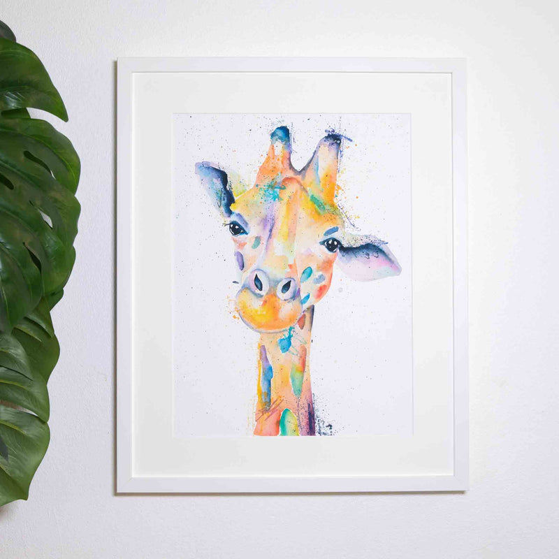 Happy rainbow giraffe in white frame on wall by SEA