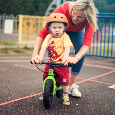 Child riding a balance bike