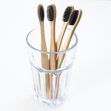 Load image into Gallery viewer, Biodegradable Charcoal Infused Bamboo Toothbrushes (single or set of 4)