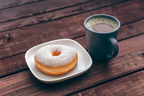 donuts in a plate and cup of tea on the side