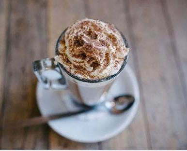 chai hot chocolate in a cup with whipped cream