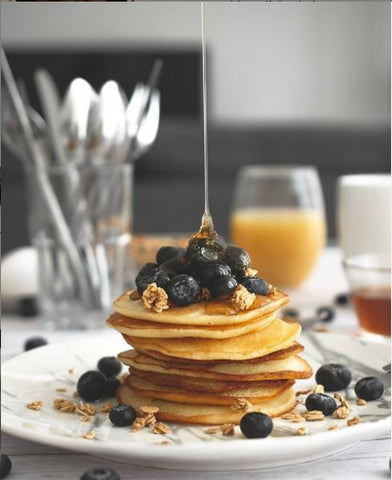 chai pancakes with blueberries and orange juice