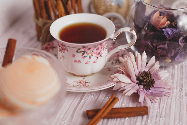 Tea cup with spices and flowers