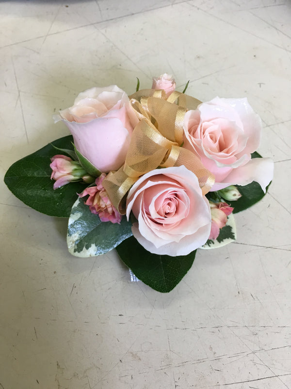 Pink spray roses and kalanchoe corsage - Winnipeg Flower Delivery by Broadway Florists