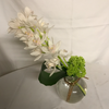 Mini cymbidium orchid in glass bowl