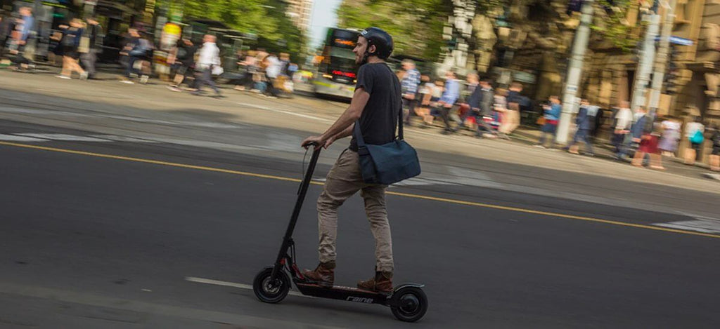 man riding scooter in the city