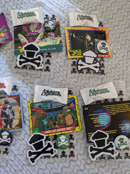 Set of 7 Johnny Cupcakes goody bags: pins, stickers, trading cards